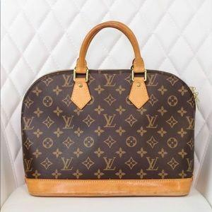 Monogrammed Alma PM Louis Vuitton Handbag